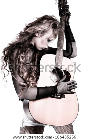 Cool rocker girl with acoustic guitar, vintage photo - stock photo