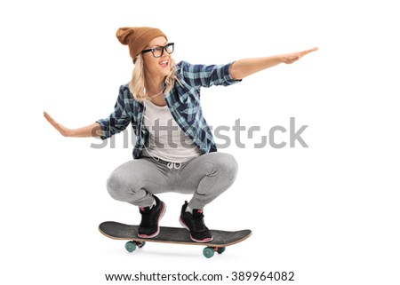 Cool skater girl riding a skateboard isolated on white background