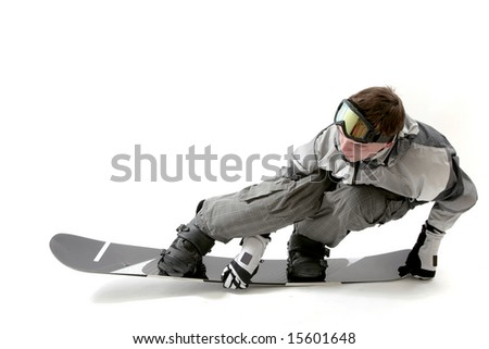Cool snowboarder flexing the board, isolated - stock photo