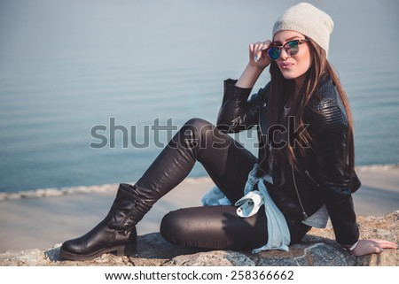 Cool strong girl posing by the river - stock photo