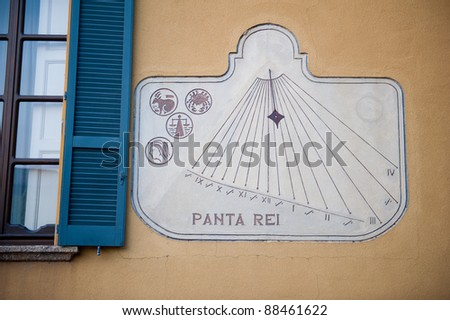 Cool sun dial on a building in Italy - stock photo