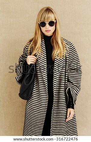 Cool sunglasses on businesswoman in studio - stock photo