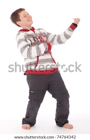 Cool teenager in red and grey top isolated playing air guitar