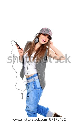 Cool teenager listening to music and dancing isolated on white background - stock photo