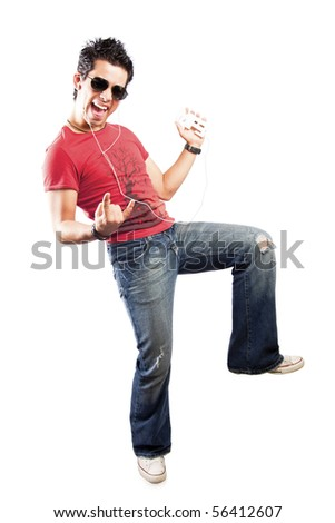 cool teenager listening to music with headphones - stock photo