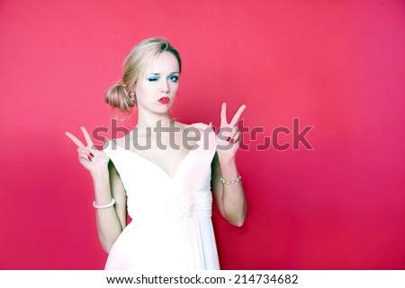 Cool woman wearing white dress on red background - stock photo