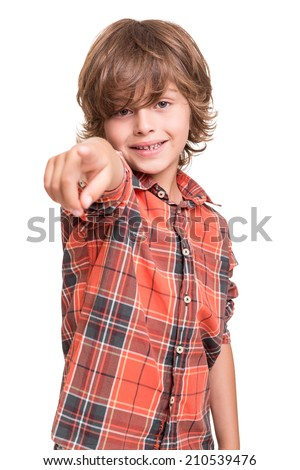 Cool young boy pointing front over white