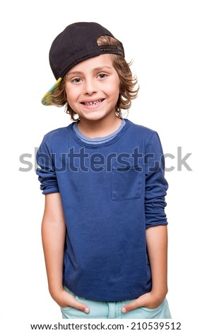 Cool young boy posing over white background - stock photo