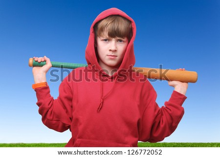 Cool young boy with baseball bat - stock photo