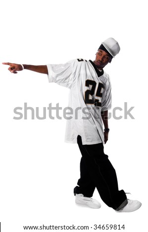 Cool young hip-hop dancer making a move - stock photo