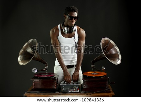 cool young man djs using two retro antique gramophones. cool and quirky concept clip