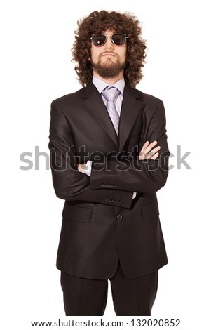cool young man with suit and sunglasses looking at camera isolated on white background - stock photo