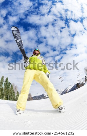 Cool young woman in mask standing and holding ski - stock photo