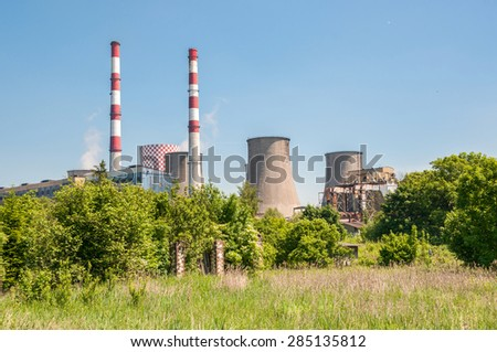 Cooling tower and chimneys of coal power plant. - stock photo