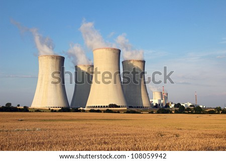 cooling tower of nuclear power plant and agriculture field - stock photo