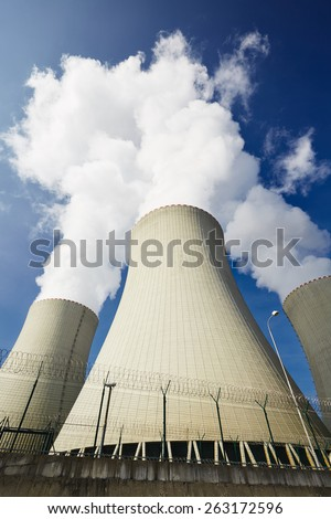 Cooling towers of the nuclear power plant  - stock photo