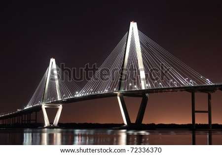 Cooper River Bridge at night in Charleston, South Carolina - stock photo
