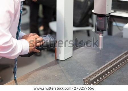 Coordinate-measuring machine. Quality control. - stock photo