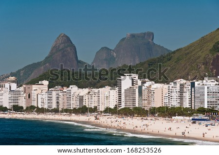 Copacabana Beach, Luxury Residential and Hotel Buildings, and Mountains Behind, Rio de Janeiro, Brazil - stock photo