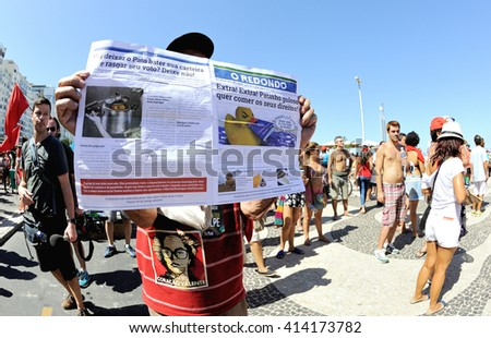 Copacabana beach, Rio de Janeiro - April 17, 2016: Supporters of the Brazilian government take part in a protest against the impeachment of President Dilma Rousseff. - stock photo