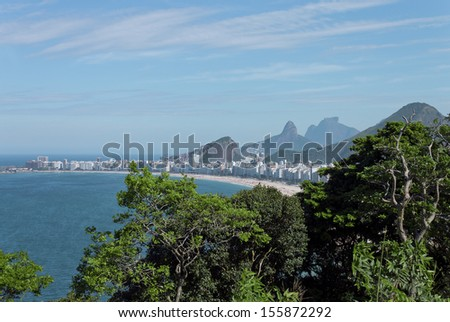 "Copacabana BEACH WITH THEIR BUILDINGS, exuberant mountains - URBAN COMMUNITIES IN CONTRAST - VIEW THE FORT ""DUKE OF CAXIAS"" - RIO DE JANEIRO - BRAZIL - stock photo"