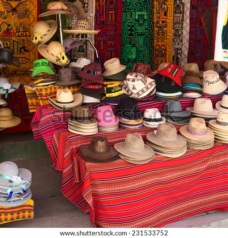COPACABANA, BOLIVIA - OCTOBER 19, 2014: Big variety of hats outside a souvenir and handicraft shop in the small tourist town on the shore of Lake Titicaca on October 19, 2014 in Copacabana, Bolivia.   - stock photo