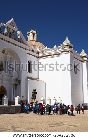 COPACABANA, BOLIVIA - OCTOBER 18, 2014: Unidentified people at entrance of the Basilica of Our Lady of Copacabana in the small tourist town at Lake Titicaca on October 18, 2014 in Copacabana, Bolivia  - stock photo
