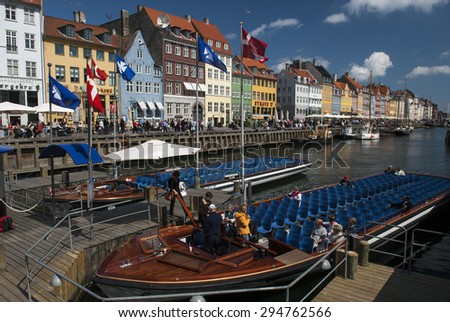 COPENAHGEN/DENMARK 09TH MAY 2007 - Tour boats in Nyhaven on a summer day - stock photo