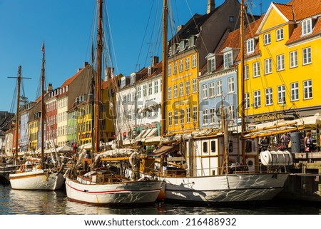 COPENHAGEN - AUGUST 30: Yachts in NYHAVN on August 30, 2014 in Copenhagen, Denmark. NYHAVN - favourite vacation spot of tourists and fans of a herring.  - stock photo