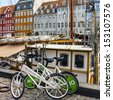 COPENHAGEN: Bicycles on the waterfront Nyhavn in the center of Copenhagen. Nyhavn is a historical district in Copenhagen. It is lined by brightly colored townhouses and restaurants. Denmark. - stock photo
