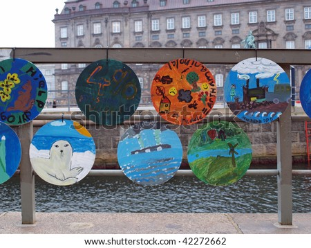 COPENHAGEN-DEC 5  Climate change themed artwork hangs outside the parliament building in Denmark while the UN climate change conference takes place in Copenhagen, December 2009 - stock photo
