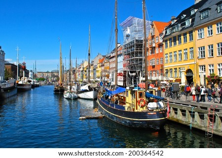COPENHAGEN, DENMARK. APRIL 9 : The Borsgade in Copenhagen is a popular destination for locals and tourists alike, where restaurants and tourist boats are available. April 9 in Copenhagen, Denmark. - stock photo