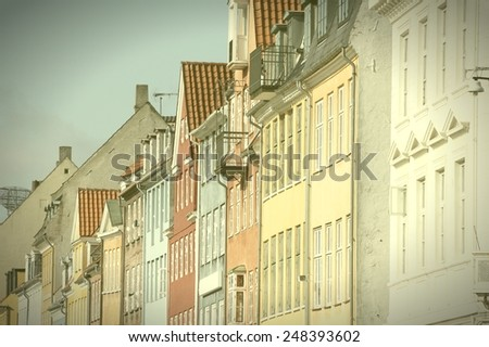 Copenhagen, Denmark. Architecture of Nyhavn. Cross processed color tone - retro style filtered image. - stock photo