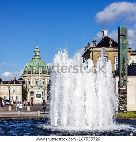 Copenhagen, Denmark: cityscape with fountain and cathedral. Frederik's Church - stock photo