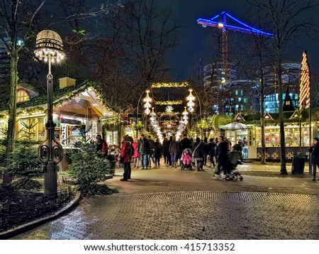 COPENHAGEN, DENMARK - DECEMBER 14, 2015: Christmas market in Tivoli Gardens. Tivoli Gardens is a famous amusement park and pleasure garden; it is the most-visited theme park in Scandinavia. - stock photo