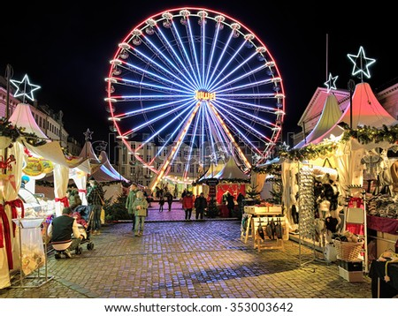 COPENHAGEN, DENMARK - DECEMBER 12, 2015: Christmas market with Ferris wheel on the Nytorv square in evening. On this market sells traditional Danish food, drinks and a wide range of winter clothing. - stock photo