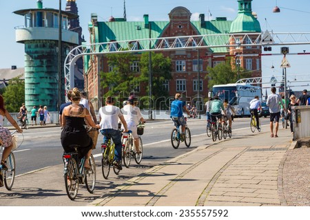 COPENHAGEN, DENMARK - JULY 25: Copenhagen is one of the most bicycle friendly cities in the World. Many people biking in centre of city in Copenhagen, Denmark July 25, 2014 - stock photo