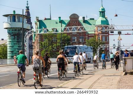 COPENHAGEN, DENMARK - JULY 25: Copenhagen is one of the most bicycle friendly cities in the World. Many people biking in centre of city in Copenhagen, Denmark July 25, 2014 - stock photo