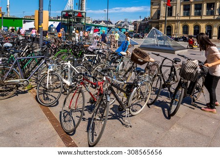 COPENHAGEN, DENMARK - JULY 25: Copenhagen is one of the most bicycle friendly cities in the World. Many bicycles parked in centre of city in Copenhagen, Denmark July 25, 2014 - stock photo