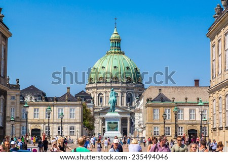 COPENHAGEN, DENMARK - JULY 25: Frederik's Church, popularly known as The Marble Church and castle Amalienborg with statue of Frederick V in Copenhagen, Denmark on July 25, 2014 - stock photo