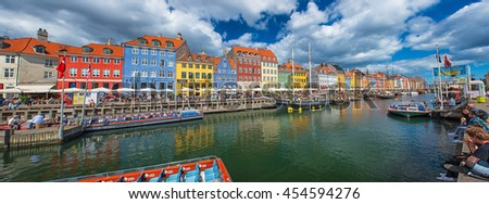 COPENHAGEN, DENMARK - 26 JUNE, 2016: Colorful houses at Nyhavn, Copenhagen on a sunny day in Denmark.