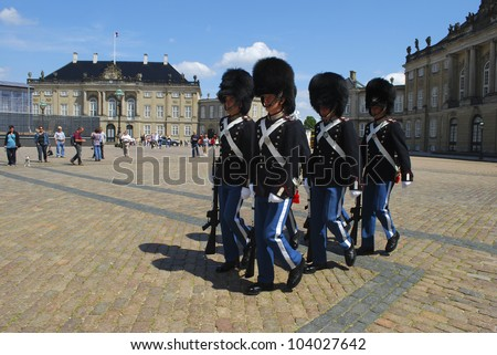 COPENHAGEN, DENMARK - JUNE 22: Royal Guards during the ceremony of changing the guards at Amalienborg Castle on June 22, 2011 in Copenhagen, Denmark
