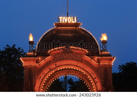 Copenhagen, Denmark - June 30, 2014: The historic main entrance of Tivoli Gardens. Opened on 15 August 1843, Tivoli gardens is the second oldest amusement park in the world. - stock photo