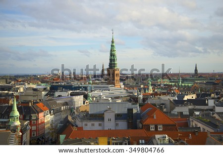 COPENHAGEN, DENMARK - NOVEMBER 03, 2014: View of the steeple of the church of St. Nicholas and the roofs of the old town November day