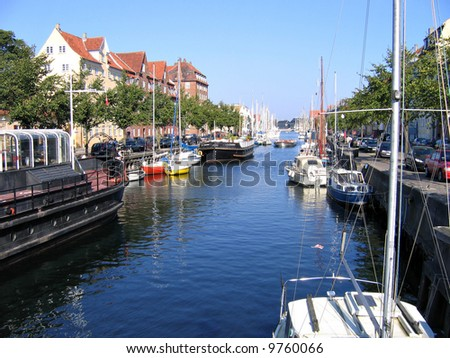 Copenhagen - houses and boats in the water front of the water canals