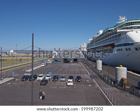 COPENHAGEN - MAY 17: Luxury cruise ships at the newly opened three-berth Ocean Quay in Copenhagen, Denmark on May 17, 2014. The quay consist of three terminals, installed with storm bollards.