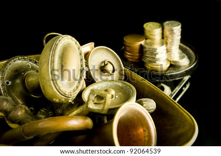 copper and brass metal on scales with money the other side showing price of metal - stock photo
