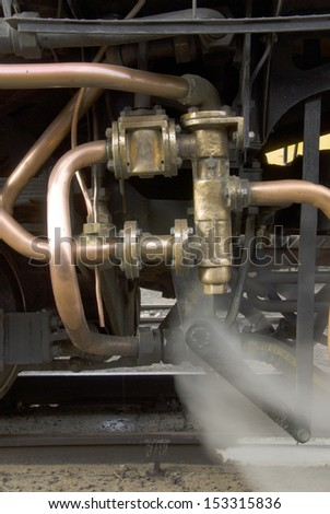 Copper and brass piping on a steam strain