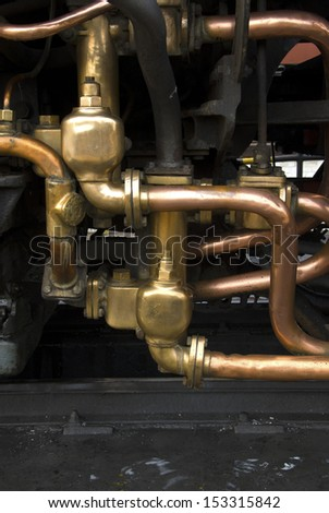 Copper and brass piping on a steam strain - stock photo