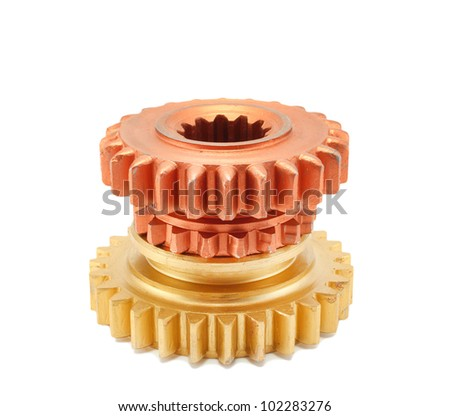 Copper and gold gear isolated on white background - stock photo